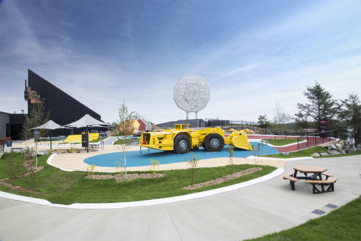 Playround with yellow truck in the middle for play and sitting areas