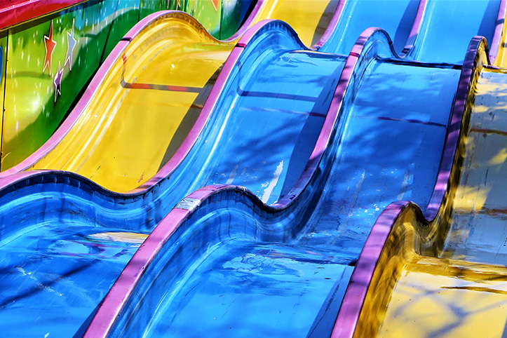 Row of waterslides that are in bad condition